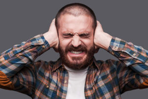Man-Covering-Ears-Because-Of-Loud-Juicer